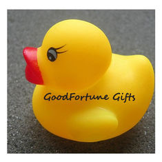 China Eco pvc rubber floating bath yellow duck for kids printed logo toy doll with sound supplier